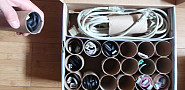 Check out this toilet paper tube cable organizer. Via Lifehacker.