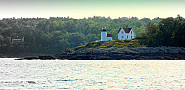 Photo of a house and lighthouse on Penobscot Bay by Librarygroover/Flickr.