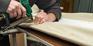 Photo of an upholsterer using an upholstery gun by AzmanL/istockphoto.com.