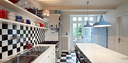 Photo of a black and white tiled kitchen in a luxury apartment by piovesempre/istockphoto.com.