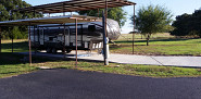 Travel trailer parked on new concrete slab