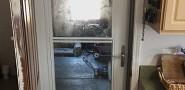 House-to-garage storm door