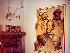 The hipster antiquarian look, complete with deer antlers and eugenicist poster. [Photo: Emilia113/Flickr]