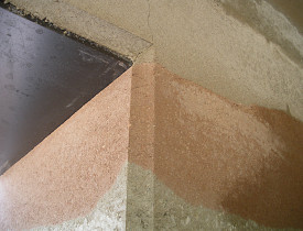 The decorative rammed earth wall that the author discusses.