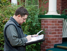 Photo of a home inspector by ImageInnovation/istockphoto.com.