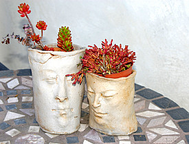 Photo of vases with faces by LynGianni/istockphoto.com