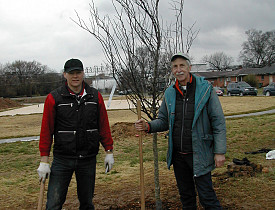 Gene Hyde, planting a tree with the CEO of the Volkswagen plant in Chattanooga.