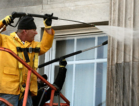 Hire a pro rather than power washing from a ladder.