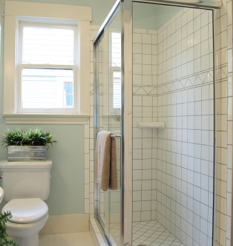 Photo of bathroom with white tile and blue walls by pink_cotton_candy/istockphoto.com.