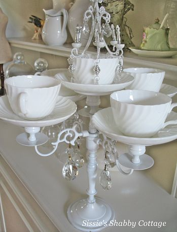 Vintage tea cups and plates are the basis of this inventive DIY candelabra. (Photo: Sissie's Shabby Cottage via Hometalk.com)