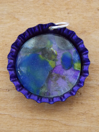 Photo of DIY bottle cap pendant by pwrgrl09bc/Flickr.