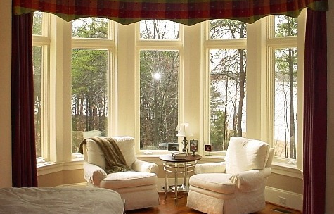Walker's Draperies showcases a bay window with a very traditional-shaped cornice treatment that outlines the inverted shape of the bay.