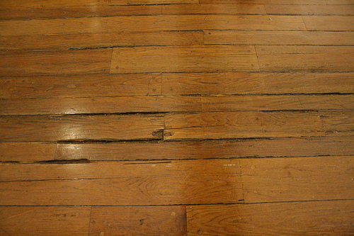 Old splintered wooden floor at Macy's - How To Fix A Warped Wood Floor - Articles - Networx