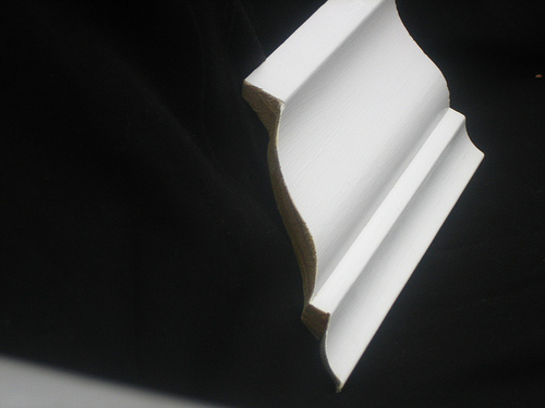 Here's what coped molding looks like: note how it's been cut along the edge of the molding. Photo: Brian Moloney/Flickr
