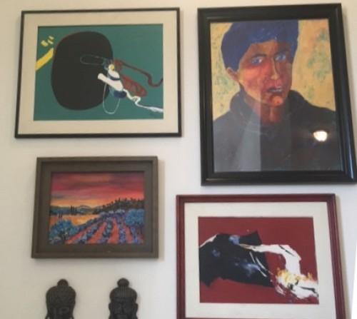 More art hung by handymen