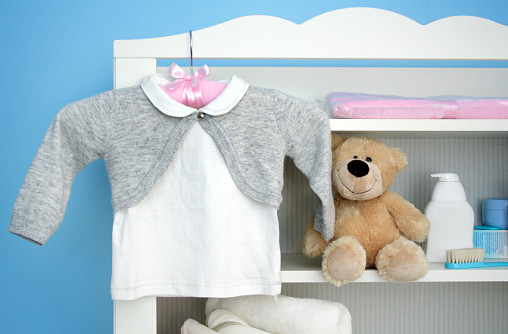 Photo of baby clothes by Kasiam/istockphoto.com.