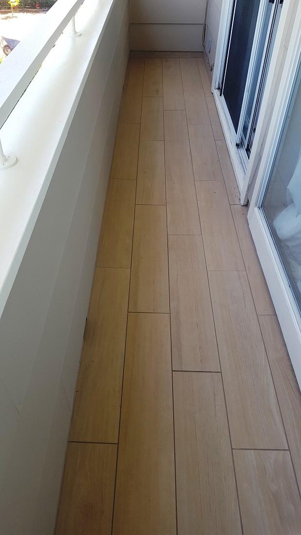 Faux wood tile on deck