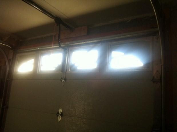 Garage door reinforced with steel bar