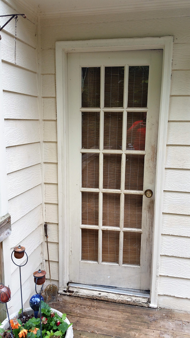 Before: old rotten, warped wood door