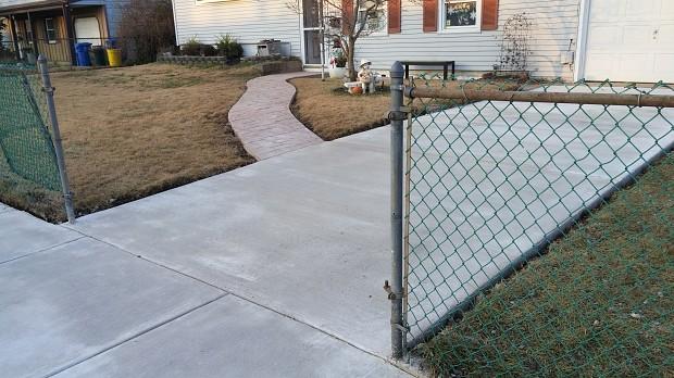 New concrete driveway, sidewalk and walkway