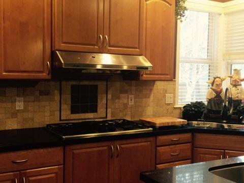 Travertine tile backsplash in the kitchen
