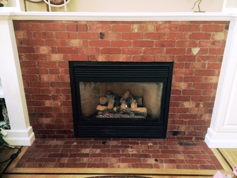Fireplace with brickwork surround and hearth