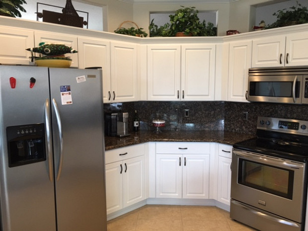 After: White painted cabinets brighten the whole kitchen
