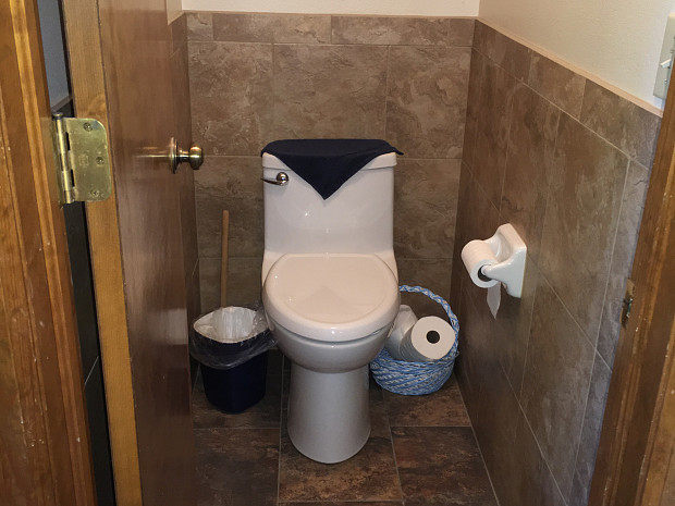 Tile wainscot in the commode room