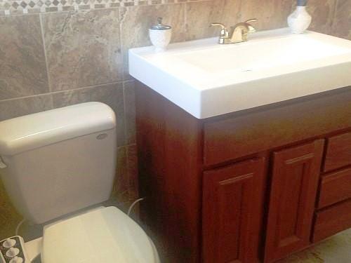 Toilet & vanity in downstairs bathroom remodel