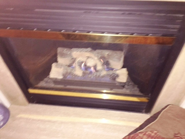 BEFORE Gas fireplace was in bad shape