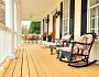 Photo of rattan and iron porch furniture by Cardmaverick/istockphoto.com.