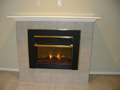 Eco friendly electric fireplaces how do they stack up for Eco friendly fireplace