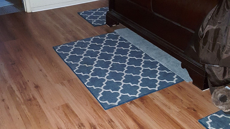 Laminate flooring installation in a sunken living room for Laminate wood flooring installation companies